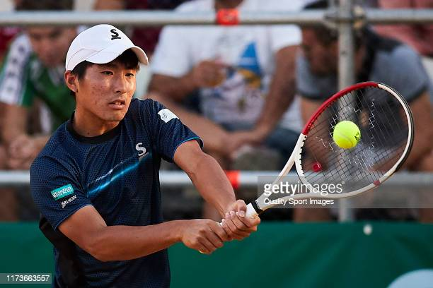 Rio Noguchi of Japan returns the ball during his Mens round of 32 match against Carlos Alcaraz of Spain on day two of the ATP Sevilla Chalenger at...