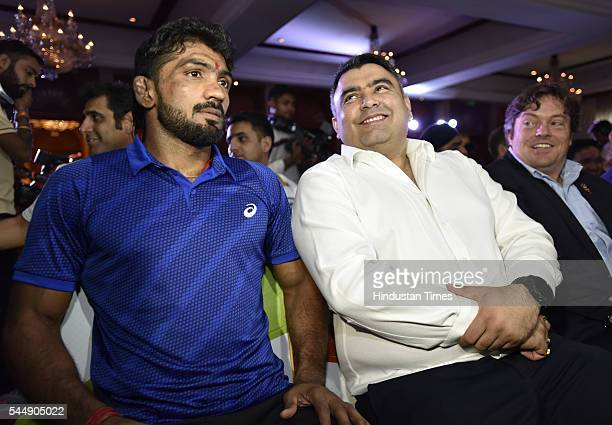 Rio Olympic bound wrestler Yogeshwar Dutt along with shooter Gagan Narang during a function organised by Olympians Association of India on July 4...