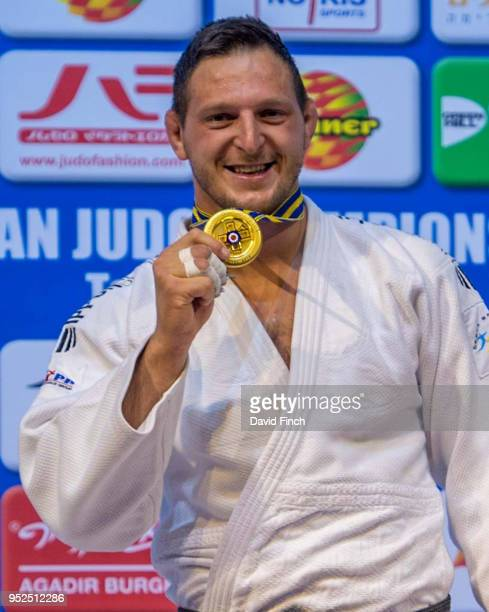 Rio Olympic champion Lukas Krpalek of the Czech Republic proudly shows his over 100kg gold medal during day three of the 2018 Tel Aviv European Judo...