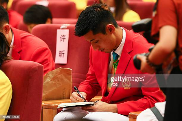 Rio Olympic Games gold medalist Zhang Jike attends the commendation meeting at the Great Hall of the People on August 25 2016 in Beijing China