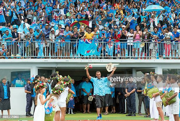 TOPSHOT Rio Olympic gold medalist Fiji rugby sevens team members enter in a stadium in Suva upon their arrival from Brazil on August 22 2016 Tens of...