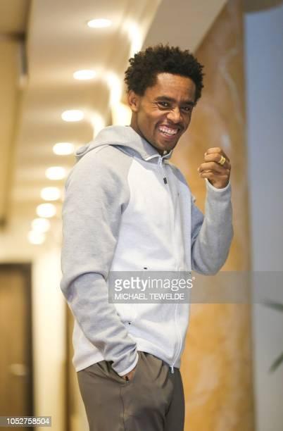 Rio olympics men's marathon silver medalist Ethiopian Feyisa Lilesa poses for a photograph on October 22 2018 at Elili Hotel in Addis Ababa Lilesa...