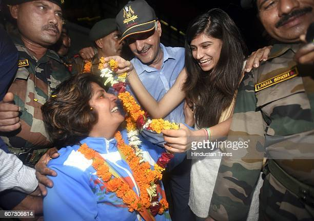 Rio Paralympics silver medallist Deepa Malik with her daughter Devika as she arrives at Indira Gandhi International Airport on September 17 2016 in...