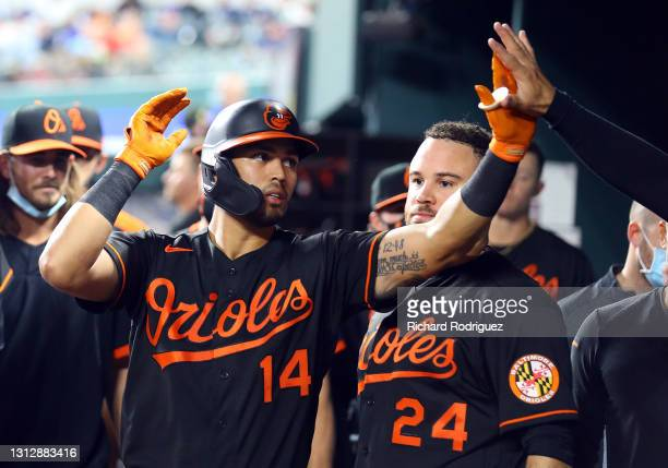 Rio Ruiz of the Baltimore Orioles celebrates with teammates in the dugout after a solo home run in the fourth inning against the Texas Rangers at...
