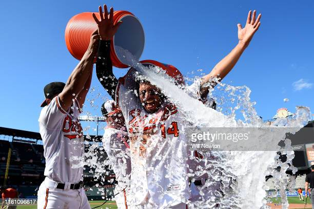 Rio Ruiz of the Baltimore Orioles is doused in water after hitting a walkoff home run against the Houston Astros at Oriole Park at Camden Yards on...