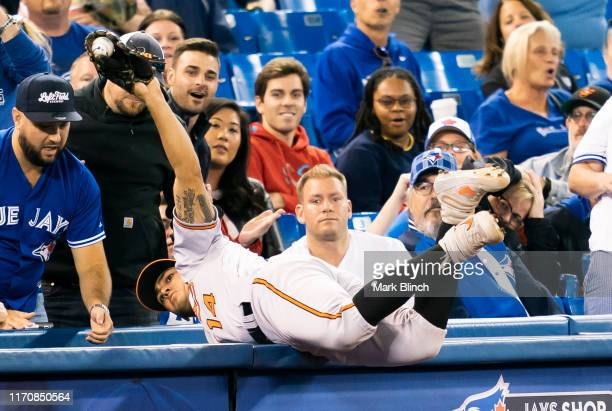 Rio Ruiz of the Baltimore Orioles makes a catch in foul territory against the Toronto Blue Jays in the second inning during their MLB game at the...