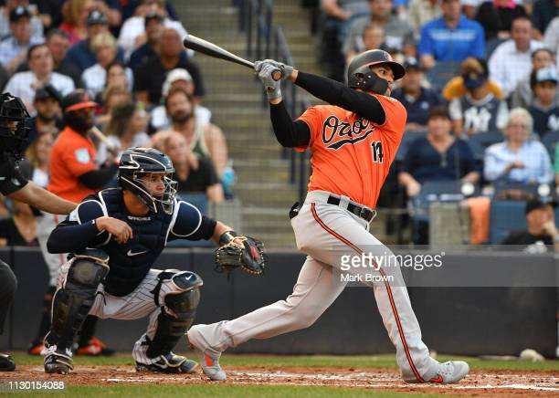 Rio Ruiz of the Baltimore Orioles singles in the second inning during the spring training game against the New York Yankees at Steinbrenner Field on...