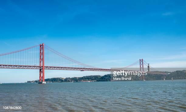 Rio Tajo with Ponte 25 de Abril, in the back Christ statue Cristo Rei, Lisbon, Portugal