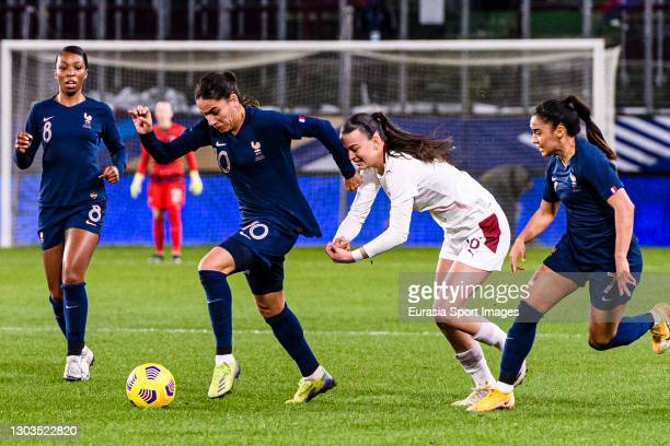 Riola Xhemaili of Switzerland chases Amel Majri of France during the friendly match between France and Switzerland at Saint-Symphorien Stadium on...