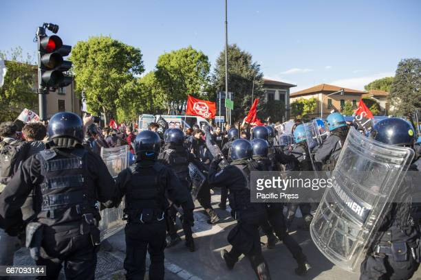 A riot between the protesters and policemen during the protest Hundreds of protesters are met in Lucca to show their disapproval for the G7 meeting...