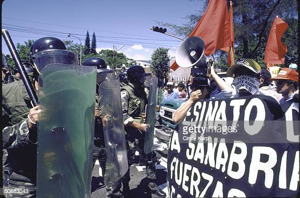 Riot control squad facing students workers peasants who are protesting assassination of Human Rights Comm president Herbert Anaya Sanabria