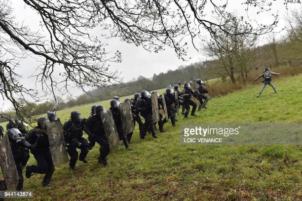 Riot gendarmes charge protesters when clashes erupt on April 10, 2018 during a police operation to raze the decade-old camp known as ZAD at...