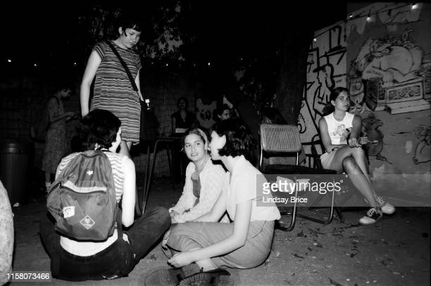 LA Riot Grrrl Convention attendees in courtyard behind Jabberjaw between bands' sets in East Hollywood on July 29 1995 in Los Angeles California