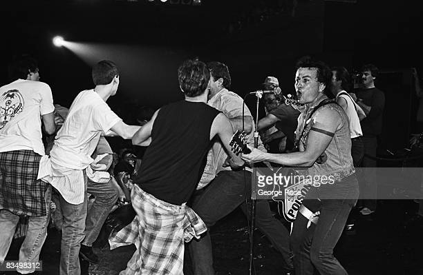 A riot on stage breaks out as the punk band Fear performs in a 1982 Reseda California concert staged at the Country Club