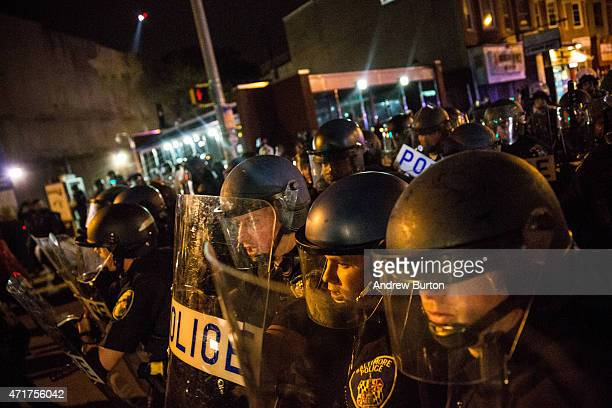 Riot police advance on protesters and media during protests in the Sandtown neighborhood where Freddie Gray was arrested on April 30, 2015 in...