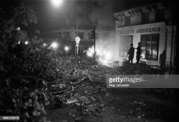 Riot police amongst the rubble in the Paris Latin Quarter during the riots France 25th May 1968
