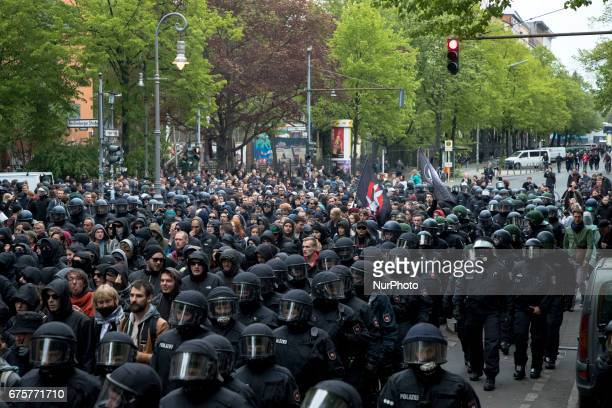 Riot police and demonstrators are pictured during the 'Revolutionary 1st May' demonstration in the Neukoelln district on May 1 2017 in Berlin Germany...