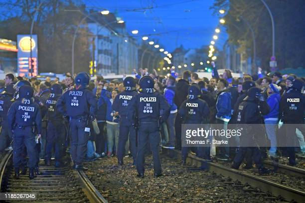 Riot police and Hertha supporters stand outside the stadium during the Bundesliga match between 1. FC Union Berlin and Hertha BSC at Stadion An der...