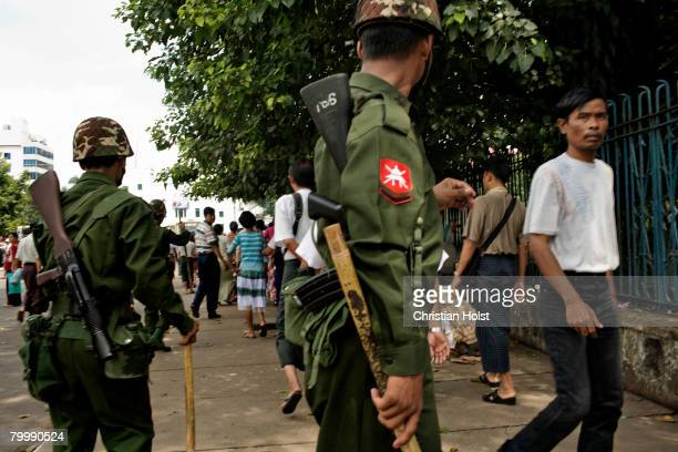 Riot police and military command people to leave the area around Sule Pagoda in front of City Hall before protesters arrive on September 26, 2007 in...