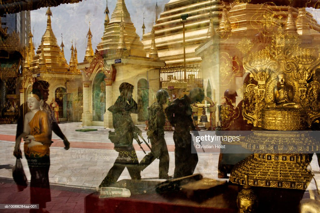 Riot police and temple reflecting on glass : News Photo