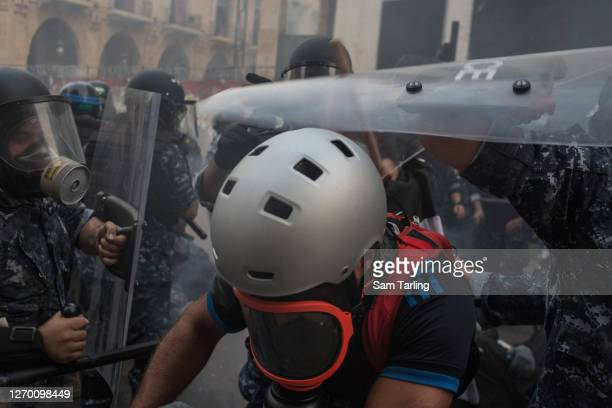 Riot police and protesters clash at an anti-government demonstration in downtown Beirut, on September 1, 2020 in Beirut, Lebanon. This week, the...