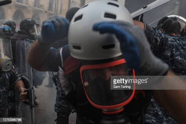 Riot police and protesters clash at an anti-government demonstration in downtown Beirut, on September 1 in Beirut, Lebanon. This week, the country's...
