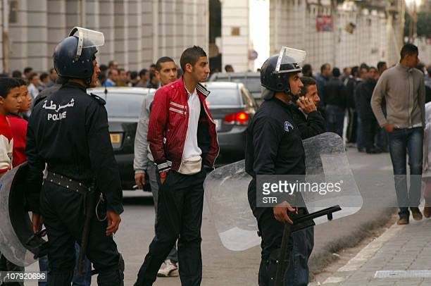 Riot police and protestors crowd the street during clashes on January 7 2011 in central Oran some 430 kilometres west of Algiers Clerics called for...