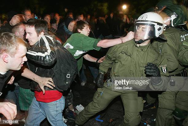 Riot police and revelers clash during the annual Walpurgis night festivities on April 30 2007 in Berlin Germany Walpurgis night is a pagan ritual...