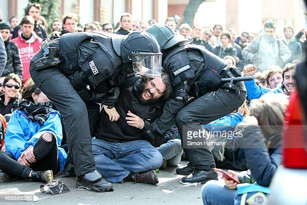 Riot police apprehend an activist during a demonstration organized by the Blockupy movement to protest against the policies of the European Central...