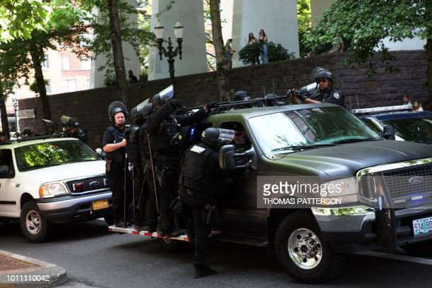 Riot police are deployed as altright activists antifascist protestors and people on all sides of the political spectrum gather for a campaign rally...