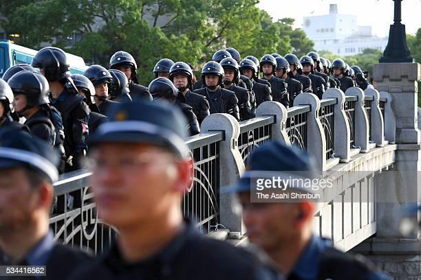 Riot police are deployed on the Motoyasubashi Bridge in preparation for the visit by US President Barack Obama on May 26 2016 in Hiroshima Japan...