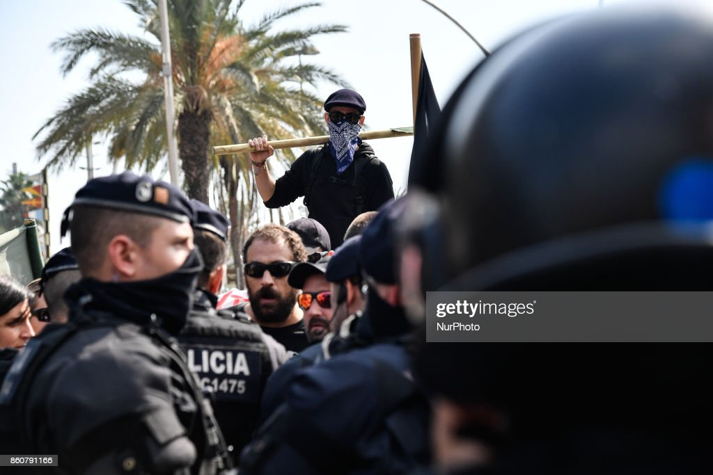 Riot police are present as anti-fascists group marched in Barcelona to protest against the Spanish National Day, in Barcelona on October 12, 2017.