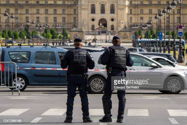 Riot police are securing the area with anti riot barriers during a demonstration against racism and police brutality at Pont Alexandre III in front...