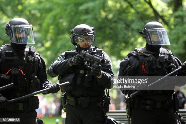 Riot police are seen as they cleared a park at a rally on June 4, 2017 in Portland, Oregon. A protest dubbed 'Trump Free Speech' by organizers was...