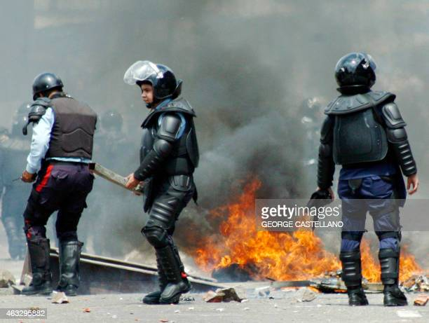 Riot police are seen next to fire after an opposition protest in San Cristobal Venezuela on February 12 2015 Opposition students marched Thursday in...