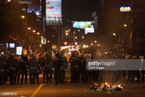 Riot police are seen on Rajavithi road during the demonstration. The pro-democracy protesters gathered at democracy monument before they drove their...