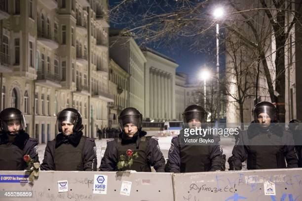 Riot police are standing still blocking a passage on Bankova street near the Presidential area on December 11 2013 in Kiev Ukraine Thousands have...