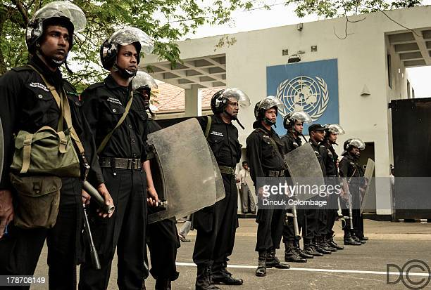 Riot police, armed with tear gas and batons, were deployed outside of the United Nations Head Office in Colombo August 26. They were there as a...