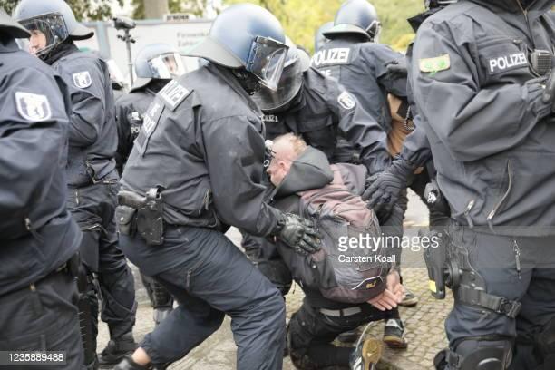 Riot police arrest a demonstrator near the left alternative site trailer Camp Kopi on October 15, 2021 in Berlin, Germany. The so-called Wagenburg...
