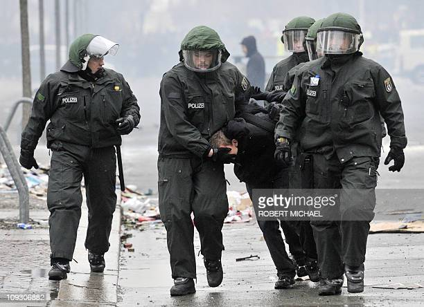 Riot police arrest a man during clashes between police and mostly left-wing protesters as riots broke out on the sidelines of a demonstrations...