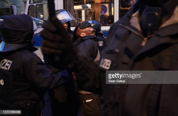 Riot police arrest a man during scattered leftwing protests in Kreuzberg district on May Day during the novel coronavirus crisis on May 1 2020 in...