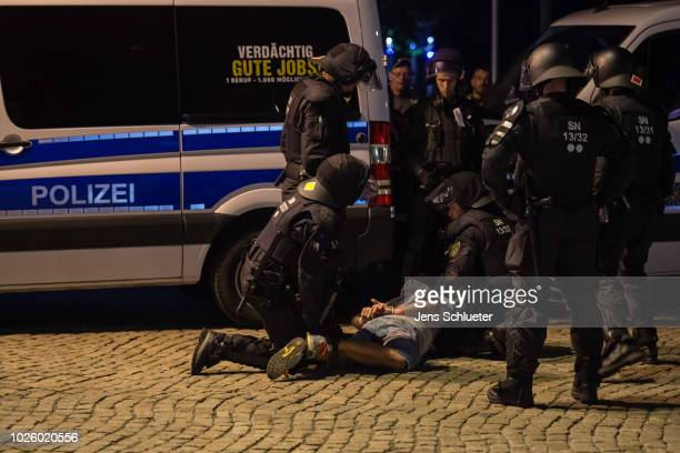 Riot police arrest a man on the verge of a rightwing march after the police closed the march following a blockade of counterdemonstrators on 1...