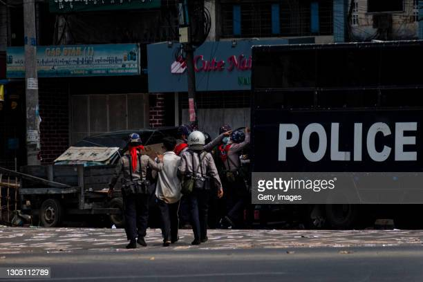 Riot police arrest a man who took part in anti-coup protests on March 03, 2021 in Yangon, Myanmar. Medics and health workers have found themselves on...