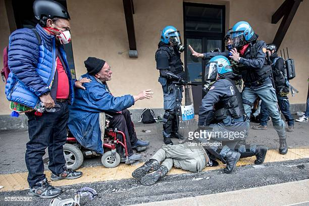 Riot police arrest a protester during a rally against the Austrian government's planned reintroduction of border controls at the Brenner Pass border...