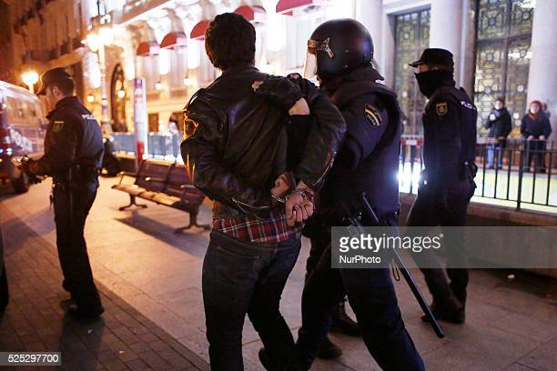 Riot police arrest a protestor accused to participate in riots in Madrid Spain Wednesday Jan 15 2014 Clashes erupted in Madrid downtown late...