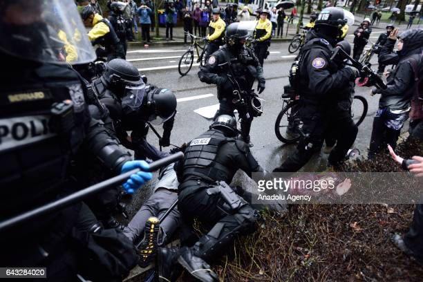 Riot police arrest a protestor during a protest against President Trump and his policies in a demonstration called Not My President's Day on...