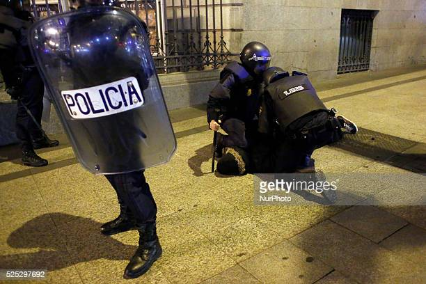 Riot police arrest a protestor next to Madrid's city council in Madrid Spain Wednesday Jan 15 2014 Clashes erupted in Madrid downtown late Wednesday...