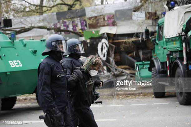 Riot police arrest an activist from the location of the left alternative site trailer Camp Kopi on October 15, 2021 in Berlin, Germany. The so-called...