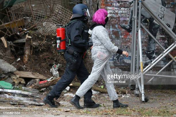 Riot police arrest an activist from the territory of the left alternative site trailer Camp Kopi on October 15, 2021 in Berlin, Germany. The...