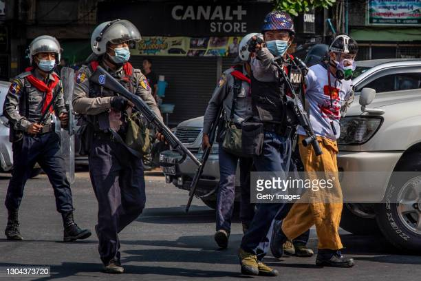 Riot police arrest anti-coup protesters on February 27, 2021 in Yangon, Myanmar. Myanmar's military government has intensified a crackdown on...